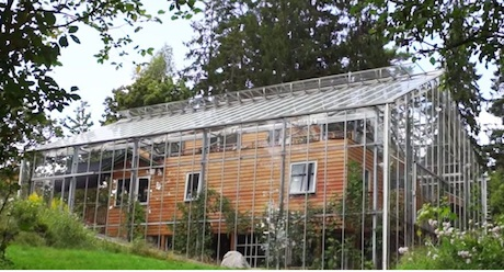 Sweden: Family designs greenhouse to wrap around home and ...